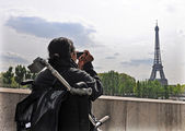 Woman In Wheelchair Taking A Picture of Eiffel Tower — Stock Photo