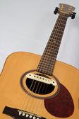 An acoustic folk guitar — Stock Photo