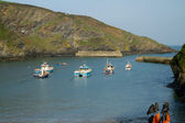 Boats moored in Port Isaac bay in Cornwall on a beautiful spring day. — Stock Photo