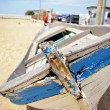 Old blue boat on the beach — Stock Photo