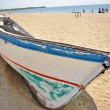 Old blue boat on the beach — Stock Photo #9319669