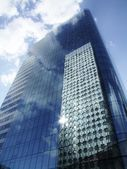 Business skyscrapers and reflections — Stock Photo