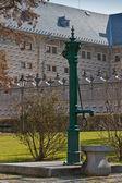 Historic water pump and sgraffito facade in Prague — Stock Photo