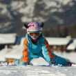 Little girl skier on her knees — Stock Photo #9054681