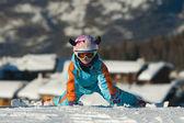 Little girl skier on her knees — Stock Photo