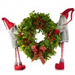 Christmas wreath carried by elves — Stock Photo #9122574