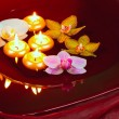 Floating candles and orchid - Stock Photo