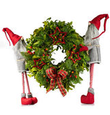 Christmas wreath carried by elves — Stock Photo