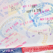 "Passport with US visa and ""admitted"" stamps — Stock Photo"