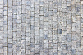 Granite cobblestoned pavement background — Stock Photo