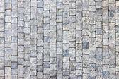 Granite cobblestoned pavement background — Stock Photo