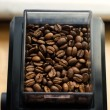 Stock Photo: Ground coffee and coffee beans in holder