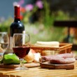 Stock Photo: Table with delicious food and wine