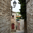 Stock Photo: Narrow street in Baux village