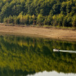 Boat in Kardzhali dam lake - Stock Photo