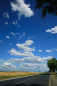 Road scene with blue sky — Stock Photo