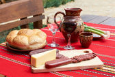 Wine, cheese and saussage on table — Stock Photo
