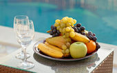 Fruits and wine glasses — Stock Photo