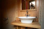 Bathroom interior with wooden theme — Stockfoto