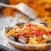 Paella with black mussels — Stock Photo