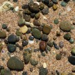 Round stones on the beach — Stock Photo