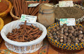 Cinnamon and other exotic spices for sale — Stock Photo