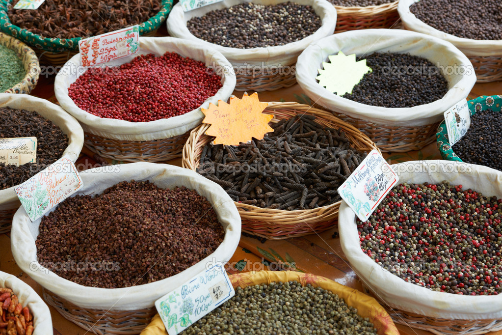 Random colored peppers spices and long black pepper from Java at market of Provence, France    #9150391