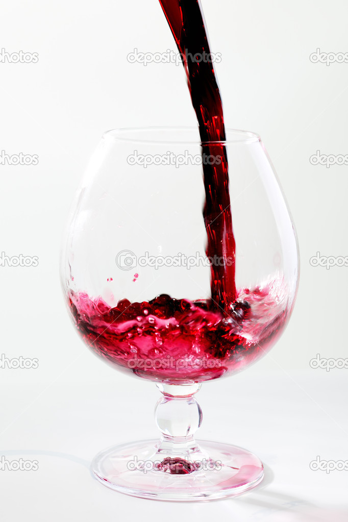 Filling a wide glas with red wine  Stock Photo #9150627