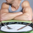 Muscular man with empty plate — Stock Photo #10232611