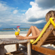 Woman with a cocktail on beach — Stock Photo