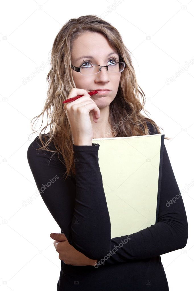Young student with a pen and notebook thinking — Stock Photo #9123875