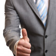 Businessman giving thumbs-up — Stock Photo