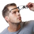 Putting on glasses — Stock Photo #9169160