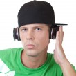 Young man concetrating on his music — Stock Photo