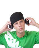 Young man holding headphones — Stock Photo