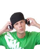 Young man holding headphones — Stock Photo