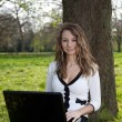 Woman in park with laptop — Stock Photo #9428859