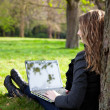 Woman in park with laptop — Stock Photo #9429458