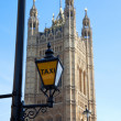 Taxi sign at Houses of Parliament Lonon — Stock Photo #9429521