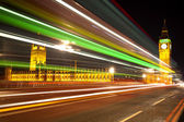 Big Ben London with lights from incoming bus — Stock Photo