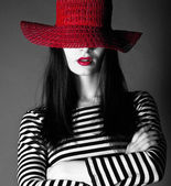 Sexy girl in a red hat with red lips — Stock Photo