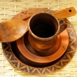 Brown clay cup, plates and wooden spoon — Stock Photo