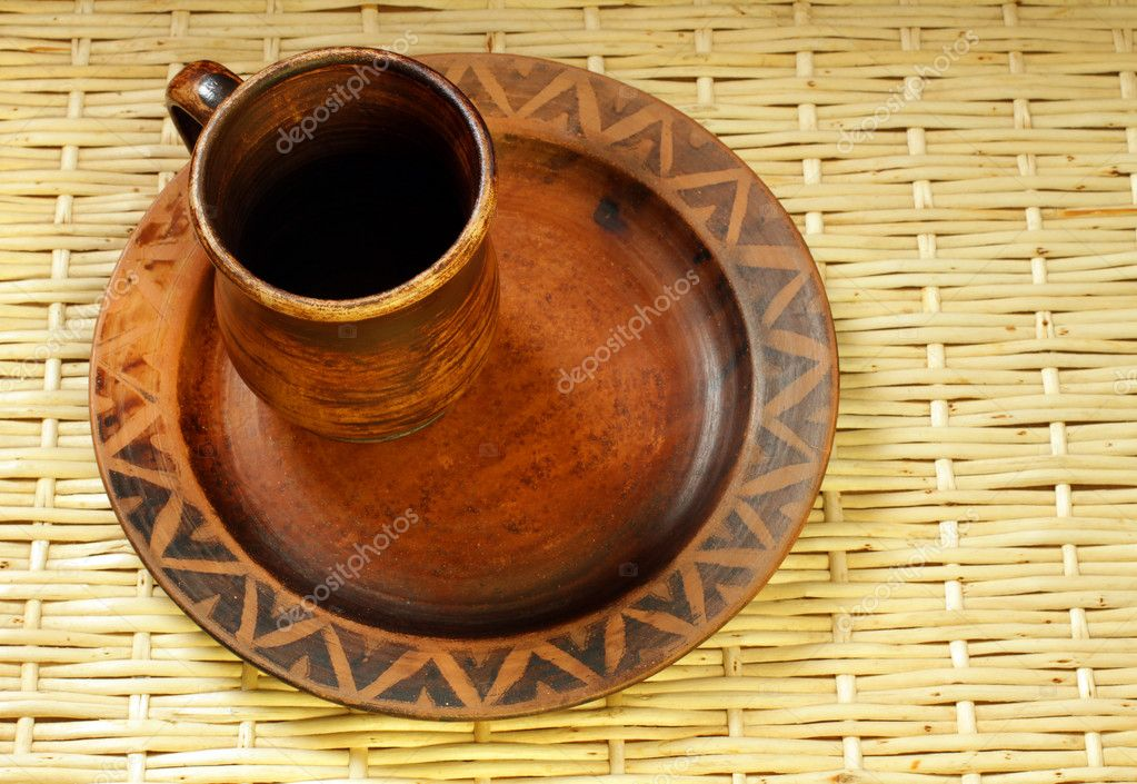 Brown clay cup and plate in ukrainian style handmade — Stock Photo #10532448