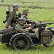 German soldiers of WW2 in motorbike — Stock Photo #9124071