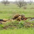 Soviet soldier of WW2 shooting in the field — Foto de Stock