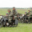 German soldiers of WW2 at motorbile - Stock Photo