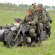 Stock Photo: Germsoldiers of WW2 at motorbile