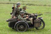 German soldiers of WW2 in motorbike — Stock Photo