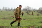 Soviet soldier of WW2 going in the field — Stock Photo