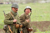German soldiers of WW2 going in the field — Stock Photo